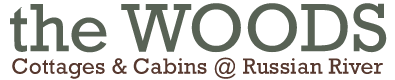 The Woods Cottages & Cabins Logo
